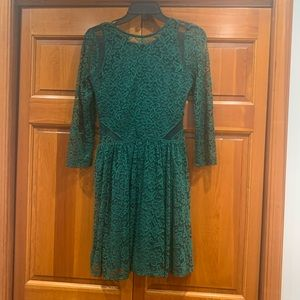 Gorgeous green lace dress with full mini skirt
